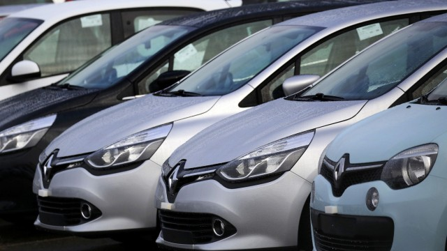 Rows of Renault cars are parked outside their Flins automobile plant in Aubergenville
