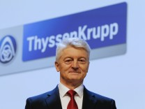 Hiesinger, CEO of ThyssenKrupp AG, poses in front of the company's logo during the annual shareholders meeting in the western German city of Bochum