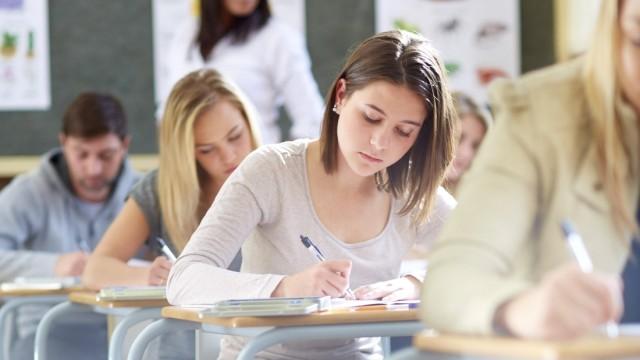 Students in classroom having an exam model released Symbolfoto property released PUBLICATIONxINxGERx