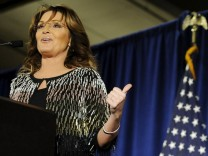 Palin points to U.S. Republican presidential candidate Trump as she speaks after endorsing him for President at a rally at Iowa State University in Ames, Iowa