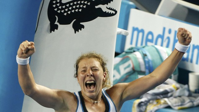 Germany's Friedsam celebrates after winning her third round match against Italy's Vinci at the Australian Open tennis tournament at Melbourne Park
