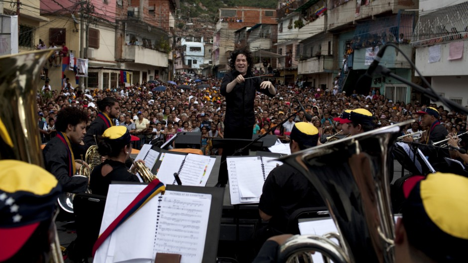 Venezuelan conductor Dudamel performs with the Simon Bolivar Youth Symphonic Orchestra during a free concert at the low-income neighborhood of La Vega in Caracas