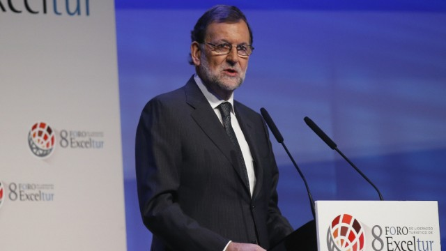 Spain's acting Prime Minister Rajoy delivers a speech at the Exceltur tourism forum in Madrid