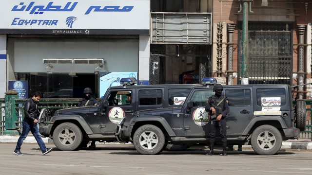 Members of security forces keep watch in Tahrir Square before the fifth anniversary of the January 25 uprising, in Cairo