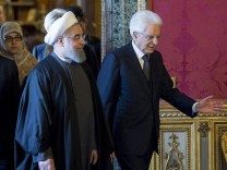 Iran's President Rouhani walks next to his Italian counterpart President Mattarella at the Quirinale presidential palace in Rome