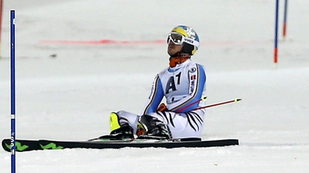 Neureuther of Germany reacts after missing to clear a pole during the men's Alpine Skiing World Cup slalom in Schladming