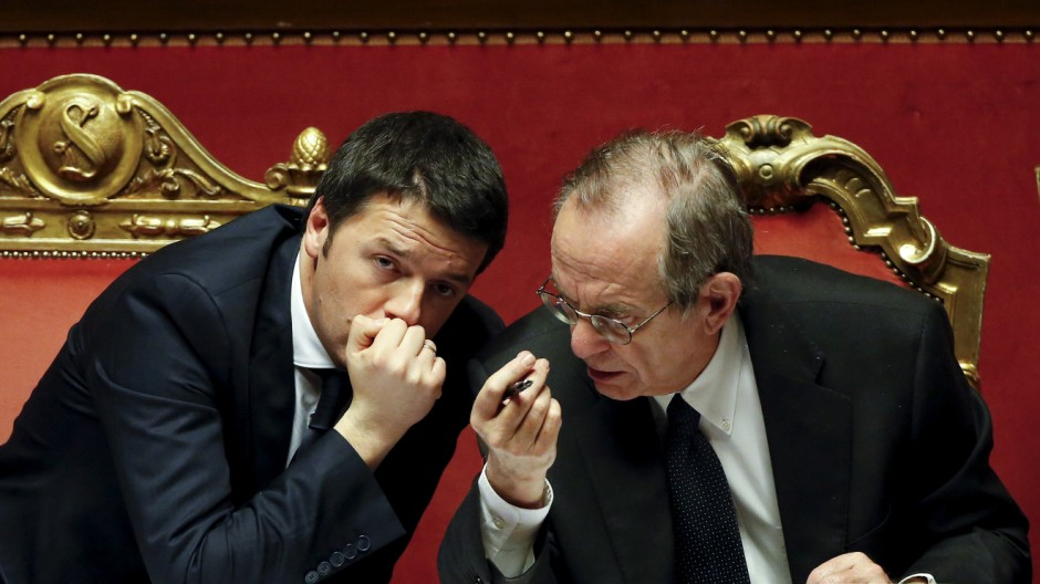 File photo of Italy's PM Renzi talking with Finance Minister Padoan during a confidence vote at the Senate in Rome