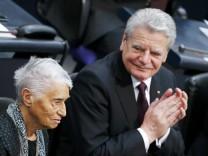 Saxony State Premier Tillich, German President Gauck and Chancellor Merkel applaud Auschwitz death camp survivor Klueger during a commemoration service in Reichstag in Berlin