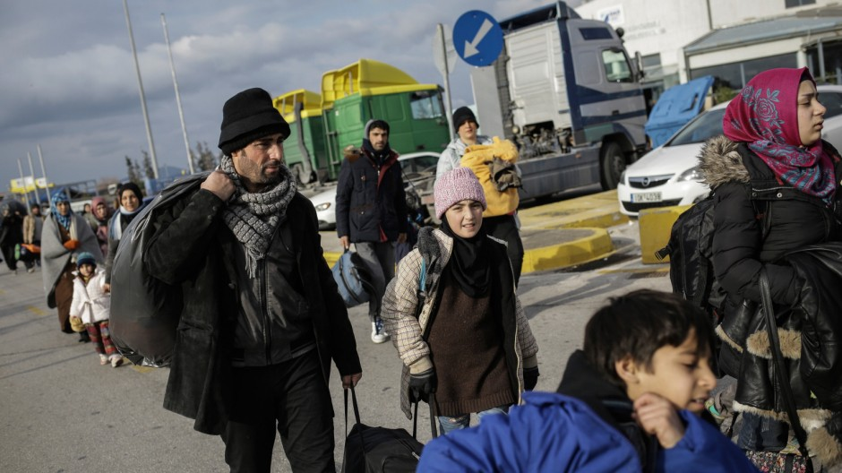 Refugees and migrants arrive at Piraeus port