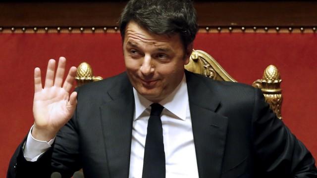 Italian Prime Minister Renzi gestures as he speaks at the Senate in Rome