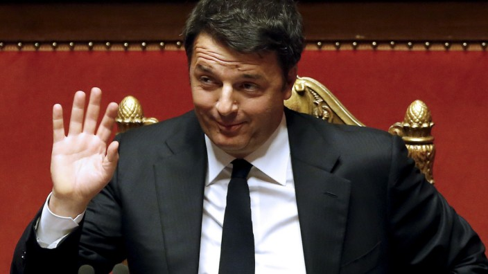 Italian Prime Minister Renzi gestures as he speaks at the Senate in Rome