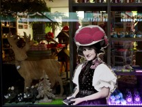 Modern interpretations of typical Black Forest souvenirs are seen in a shop window in the old town of Freiburg