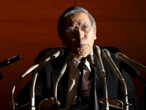 Bank of Japan Haruhiko Kuroda speaks next to a panel to explain his policy during a news conference at the BOJ headquarters in Tokyo