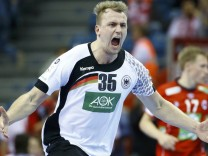 Kuehn of Germany celebrates a goal against Norway during their Men's European Handball Championship match in Krakow