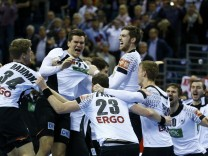 German players celebrate victory against Spain in their Men's European Handball Championship final match in Krakow