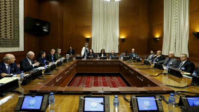 Asaad Al-Zoubi, head of the Syrian opposition delegation, and Salim al-Muslat, spokesman for the High Negotiations Committee, attend peace talks with U.N. mediator for Syria Staffan de Mistura in Geneva