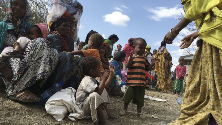 Malnourished children wait for medical attention at the Halo health post in Halo village, a drought-stricken area in Oromia region in Ethiopia