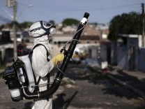 A municipal worker sprays insecticide at the neighborhood of Afogados in Recife