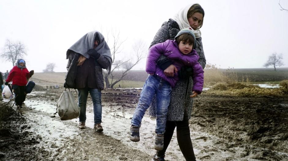 Migrants Cross The Serbian Border In Sub Zero Temperatures