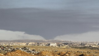 Smoke rises over the industrial city in Aleppo, Syria