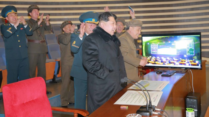 North Korean leader Kim Jong Un reacts as he watches a long range rocket launch in this undated photo released by North Korea's Korean Central News Agency (KCNA) in Pyongyang