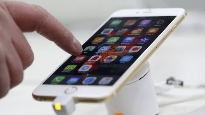 A man tests a mobile phone in a shop in Munich