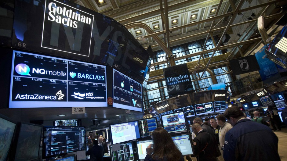 File photo of the Goldman Sachs logo on their post as traders work on the floor of the New York Stock Exchange in New York