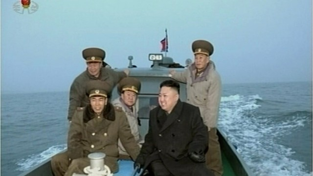 Still image taken from video shows North Korean leader Kim Jong-un travelling with senior military officials on a boat at an undisclosed location