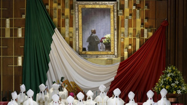 Pope Francis is seen praying in front of the image of Our Lady of Guadalupe while celebrating mass at the Basilica of Guadalupe in Mexico City