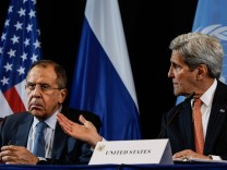 MUNICH GERMANY FEBRUARY 12 2016 Russia s Foreign Minister Sergei Lavrov L and US Secretary of
