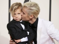 Singer Justin Bieber and his brother, Jaxon, arrive at the 58th Grammy Awards in Los Angeles