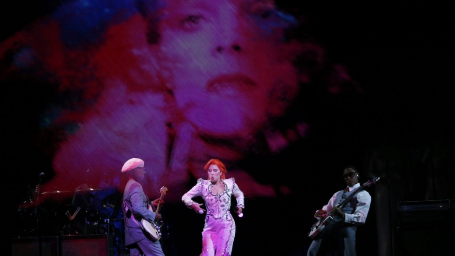 Lady Gaga performs a medley of songs as a tribute to the late Bowie with Bowie collaborator guitarist Rogers at the 58th Grammy Awards in Los Angeles