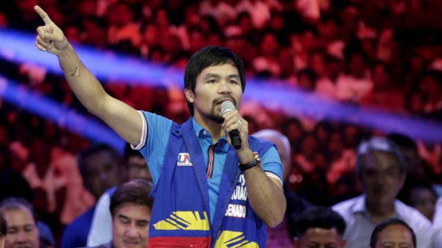 Filipino boxer Manny Pacquiao, who is running for Senator in the May 2016 national elections, speaks to supporters during the start of elections campaigning in Mandaluyong city, Metro Manila