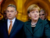 German Chancellor Merkel and Hungarian Prime Minister Orban arrive for news conference in Budapest
