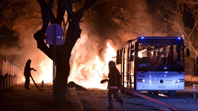 Firefighters prepare to extinguish fire after an explosion in Ankara