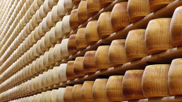 A file photo of a storage area for Parmesan cheese wheels being pictured at a warehouse owned by Credito Emiliano bank in Montecavolo