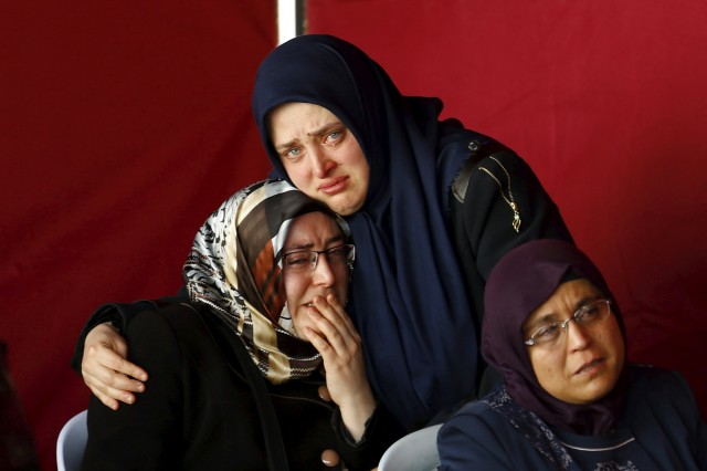 Family members and relatives of Wednesday's car bombing victims mourn outside a morgue in Ankara