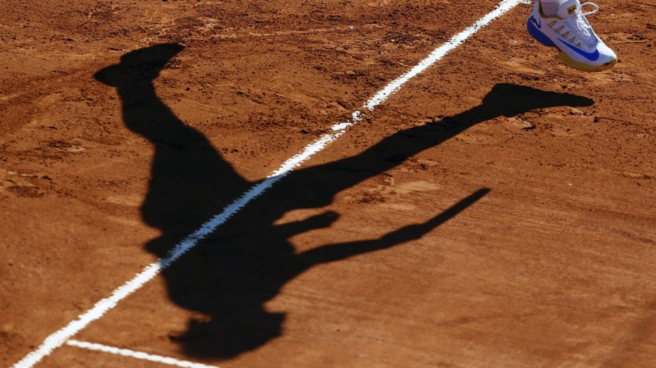 Spain's Nadal casts his shadow as he serves during his tennis match against Italy's Lorenzi at the ATP Argentina Open in Buenos Aires