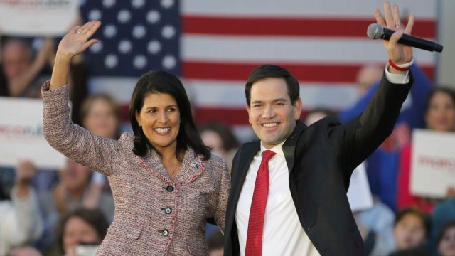 South Carolina Governor Haley and U.S. Republican presidential candidate Rubio react on stage during a campaign event in Chapin