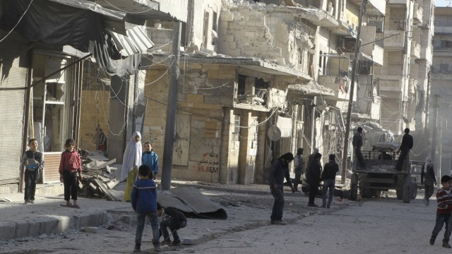 Residents inspect damage after an airstrike on the rebel held al-Fardous neighbourhood of Aleppo