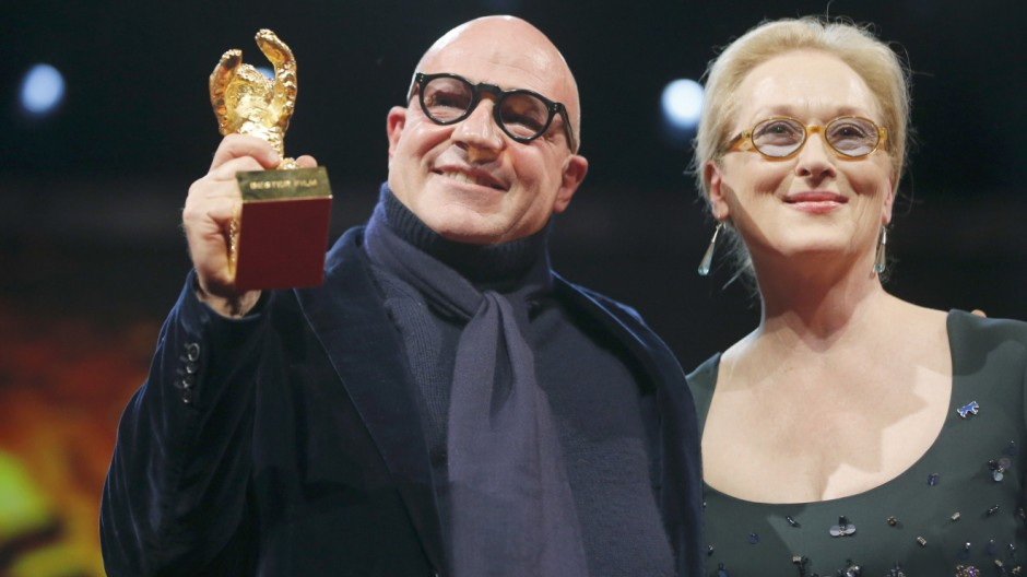 Director Gianfranco Rosi poses with Jury President Streep after receiving Golden Bear during awards ceremony at 66th Berlinale International Film Festival in Berlin