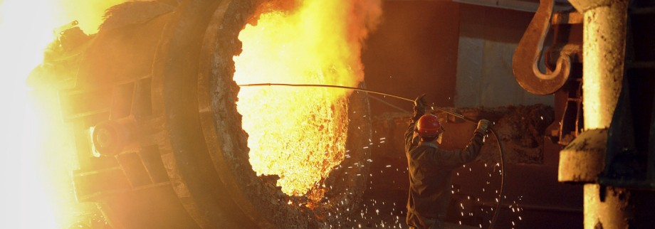 File photo of a steel worker operating a furnace at a steel manufacturing plant in Hefei