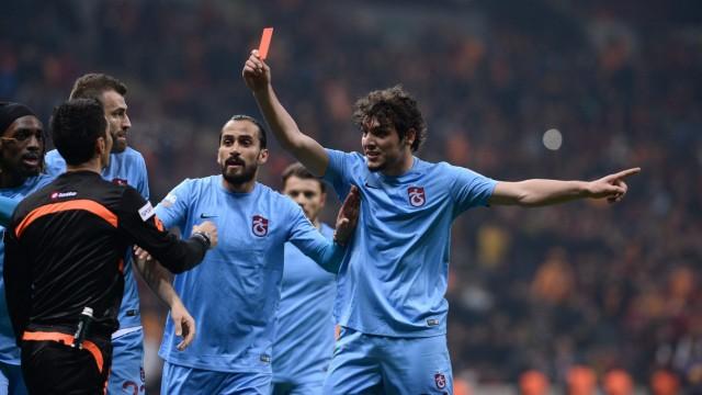 Trabzonspor's Salih Dursun shows red card to Referee Deniz Ates B