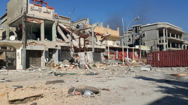 Destroyed buildings are pictured after clashes between military forces loyal to Libya's eastern government and Islamist fighters, in Benghazi, Libya