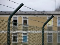 House of refugee deportation registry centre is pictured behind a fence in Manching