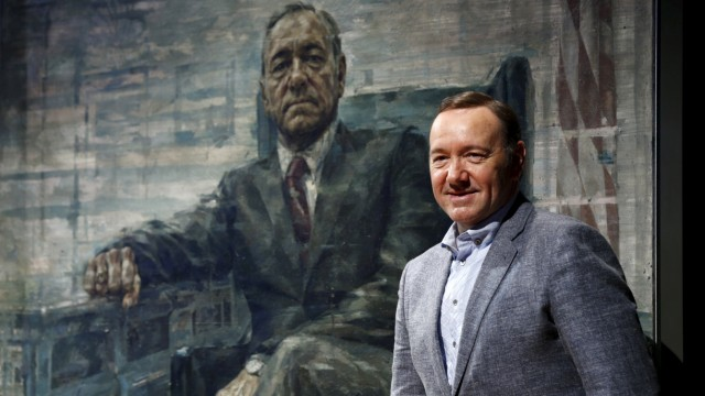 Actor Kevin Spacey beside his House of Cards portrait in Washington