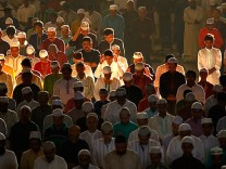 Muslims attend Eid al-Adha morning prayers