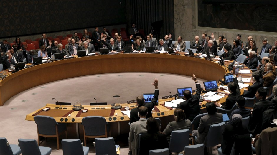The United Nations Security Council votes to approve a resolution endorsing the planned halt in fighting in Syria at the United Nations Headquarters in New York