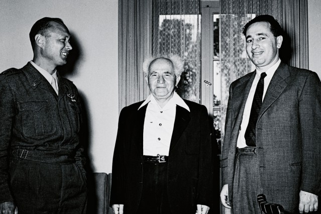 Israel's Defence Minister Ben Gurion stands with Dayan and Director General of the Ministry of Defence Peres in Tel Aviv; shimon peres 1