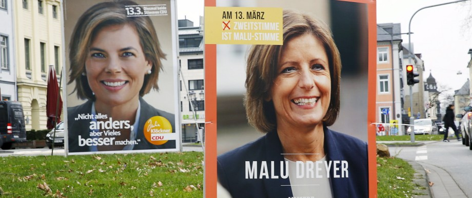 Election campaign posters of Dreyer and Kloeckner are seen in Koblenz